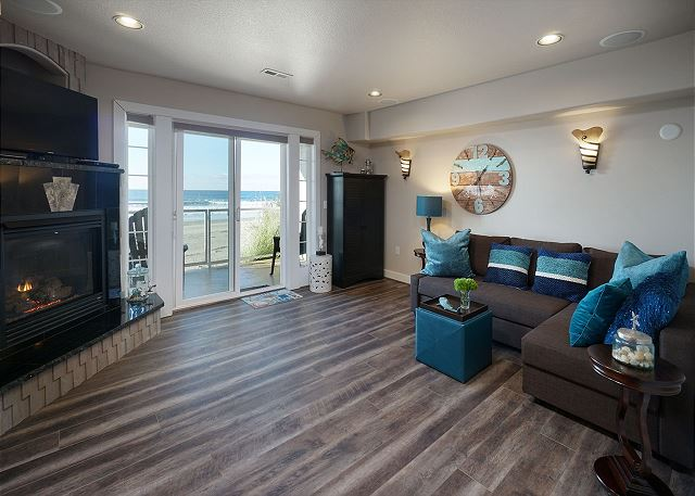 First floor family room provides sleeping options for 4 more (queen sofa sleeper and Murphy bed) plus gas fireplace & TV