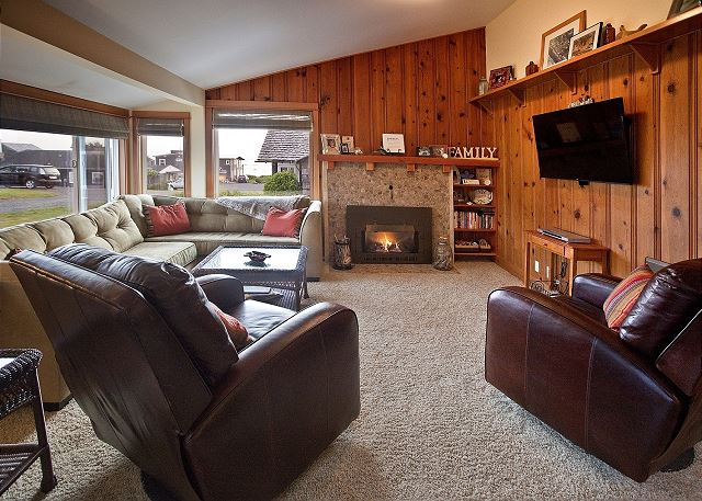 Comfy living room with gas fireplace and cable equipped HDTV + DVD player
