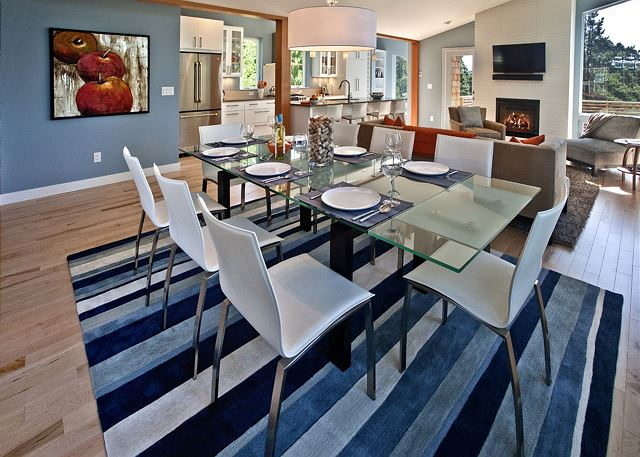 Imagine lively and leisurely conversations around the large dining room table.