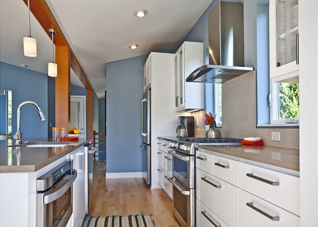 Kitchen is fully-equipped and includes a double oven, microwave drawer, and ultra-quiet dishwasher.