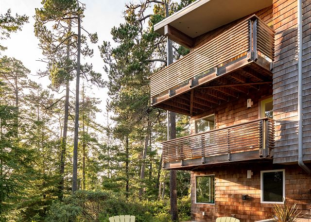 Nestled in a grove of trees on a private lot you'll love this modern treehouse!