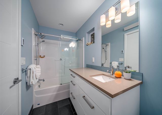 2nd bathroom with tub/shower enclosure.  This home comes with lots of soft, plush towels.