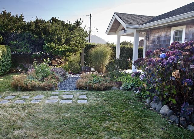 Lovely manicured yard and private hot/cold outdoor shower welcomes you