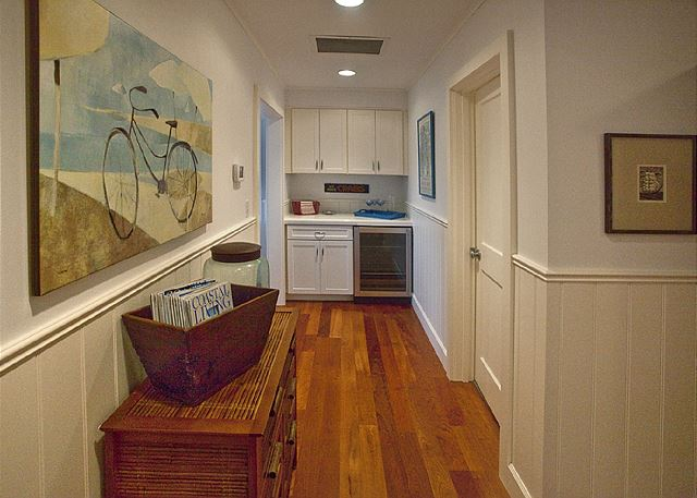 Hallway between east and west wing of the house. Wine cooler and galley for mixing your favorite beach drinks