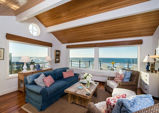 Large picture windows in the front room are perfectly designed to capture the ocean view