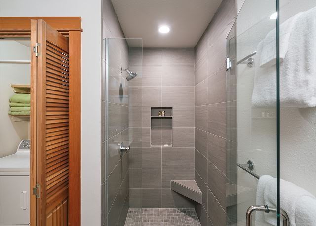 Downstairs bathroom with walk-in shower, plush towels and laundry closet