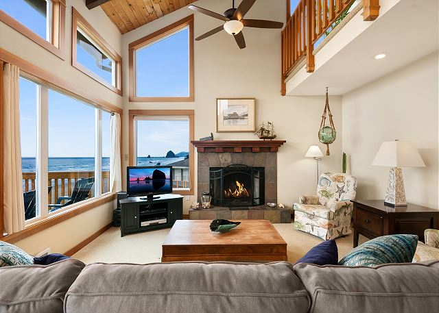 Living room with gas fireplace and cable-equipped flatscreen TV