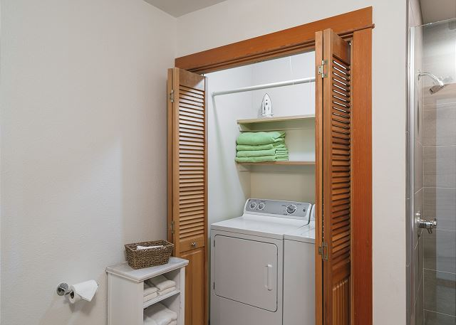 Full-sized washer/dryer with laundry soap provided