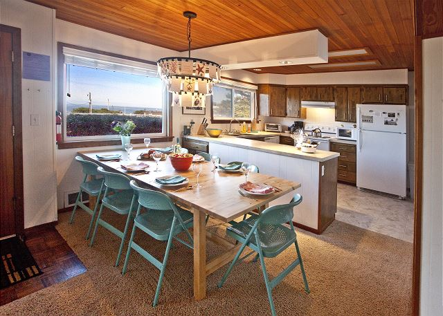 Dining room and kitchen both provide ocean views