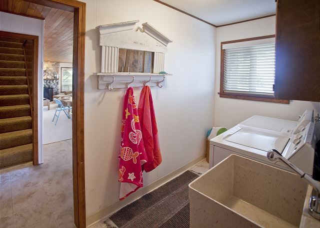 Convenient full-size washer and dryer & utility sink for washing up after a day at the beach