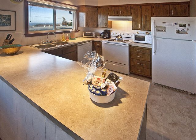 Spacious and well-equipped kitchen with ocean view!