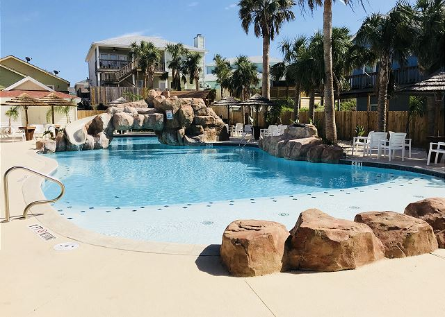 Surrender to Island Time! Beautiful pool that features an awesome slide for little and plenty of space for the big kids!