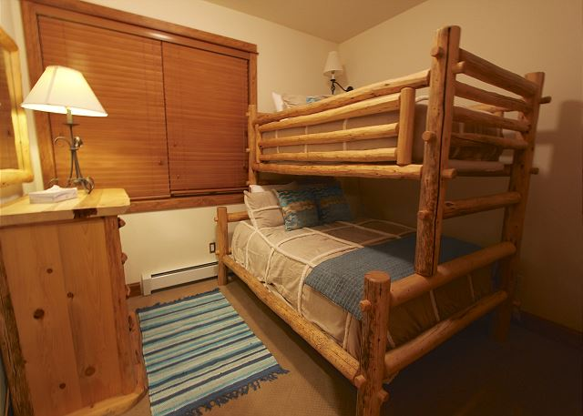 Second guest bedroom has a bunk with a twin-sized bed on the top and a full-sized bed on the bottom.