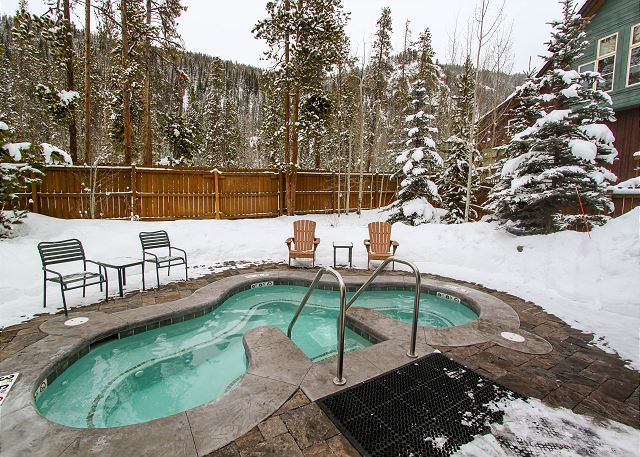 The complex also offers a shared hot tub for guests.