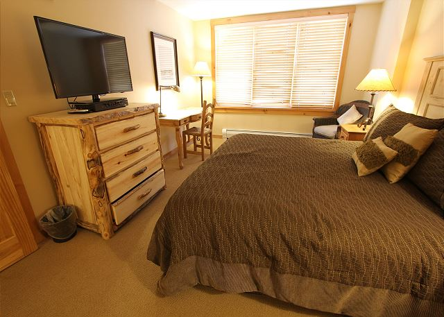 Master Bedroom features a king-sized bed, dedicated workspace and flat screen TV.