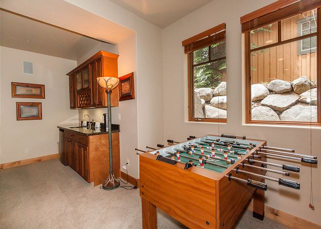 The recreation room in the basement offers comfortable seating in front of a flat screen TV and gas fireplace. Enjoy a movie night, game night or fun with foosball and ping pong tables.
