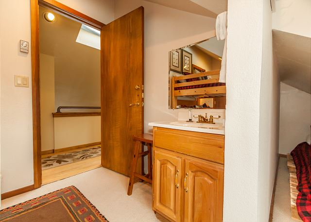 The first guest bedroom offers added convenience with a single sink vanity inside the room.