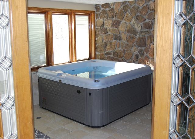 The private indoor hot tub is located just off of the living area.