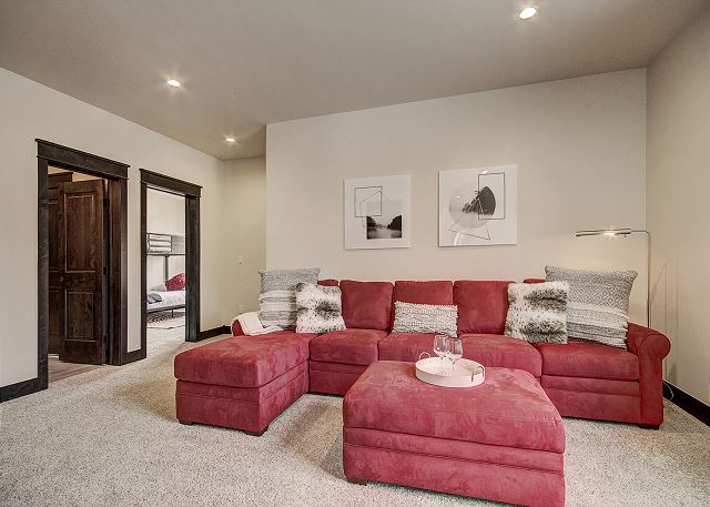 The den offers comfortable seating around a flat screen TV and a queen-sized sleeper sofa.