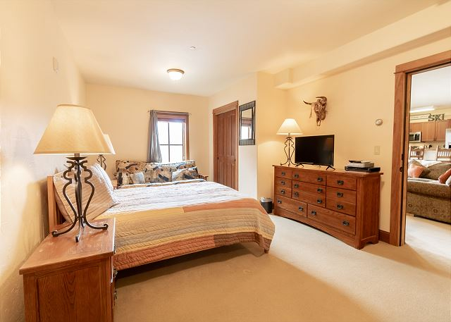 The third bedroom features a king-sized bed, a flat screen TV, and a kitchenette with full-sized refrigerator, oven, microwave, and coffee maker.