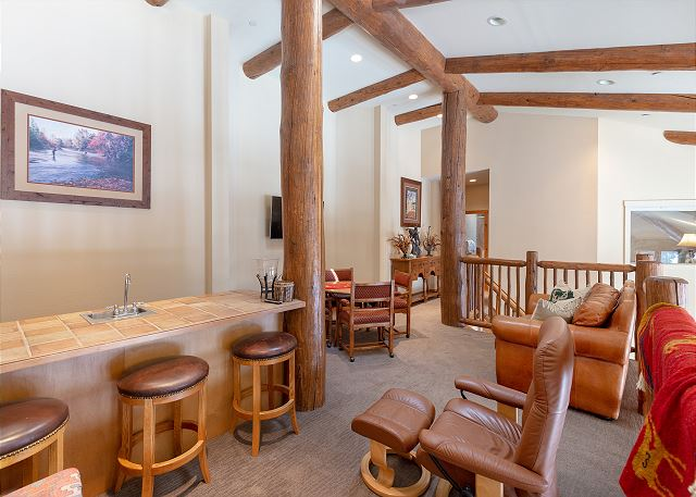 The upstairs loft features comfortable seating, a game table and a wet bar.