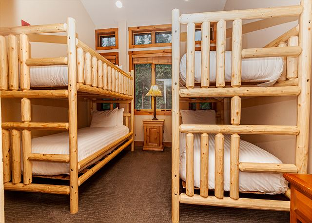 The second guest bedroom features two extra-long twin-sized bunk beds, a flat screen TV and an en suite bathroom.