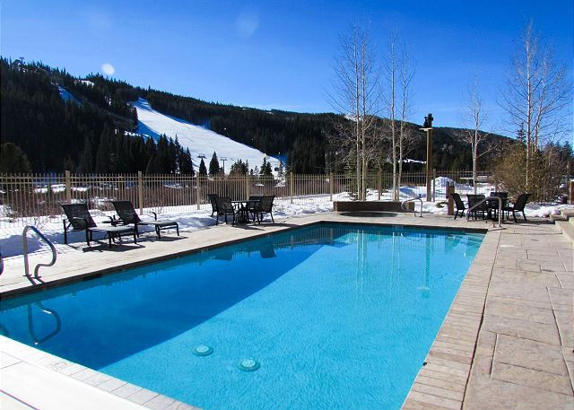 Enjoy stunning ski slope views from the shared pool.