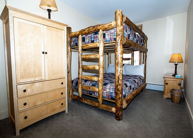 The guest bedroom features a full-sized bunk bed.