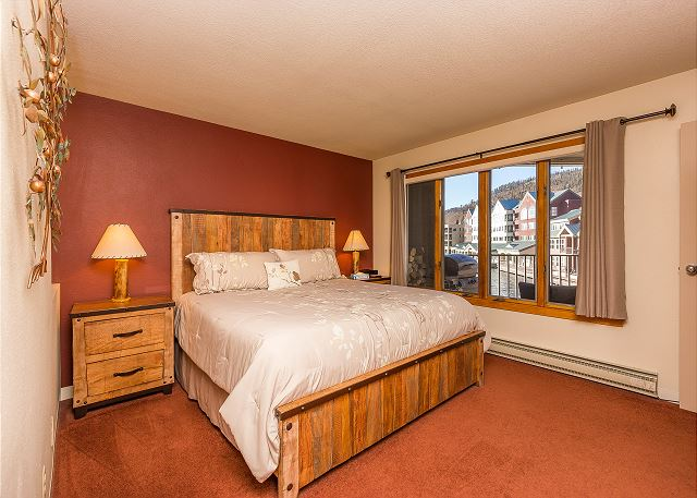 The bedroom features a king-sized bed and flat screen TV.