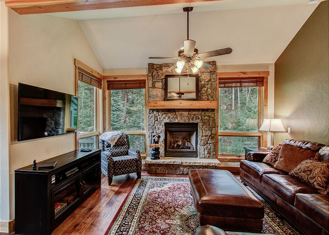 The living area features a flat screen TV and beautiful gas fireplace.