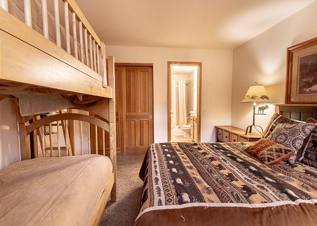 The second guest bedroom features a queen-sized bed, bunk bed and an en suite bathroom.