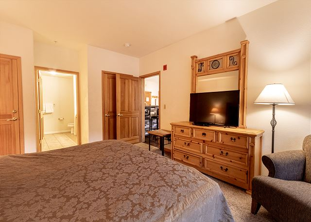 The master bedroom features a king-sized bed, flat screen TV and its own entrance to the private balcony.