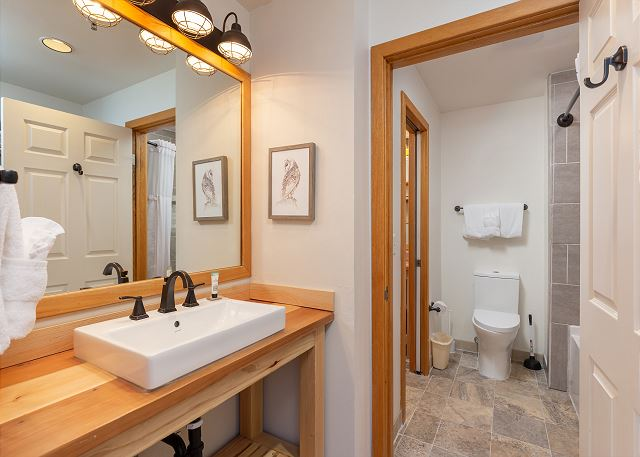 The bedroom has its own entrance to the bathroom and its own vanity.