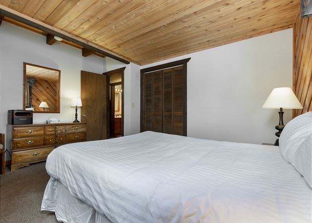The third guest bedroom features a queen-sized bed with Ivory White Bedding.