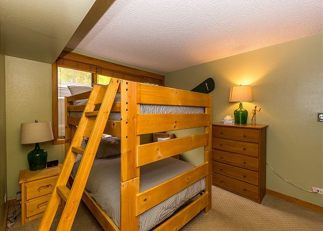 The guest bedroom sleeps four with a full-sized bunk bed.