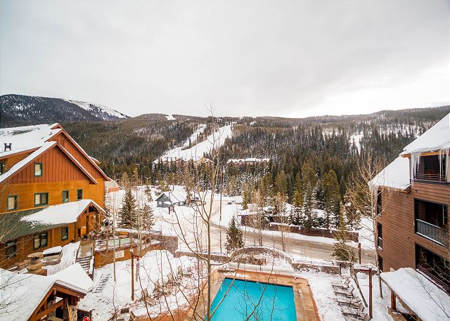 The private balcony overlooks the shared pool and hot tubs and features beautiful ski slope views.