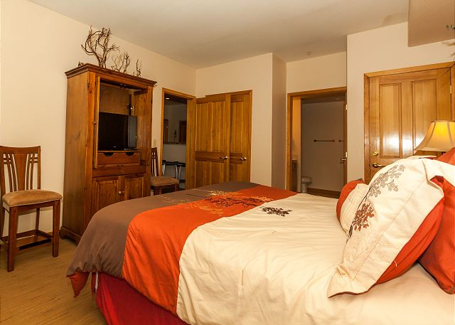 The master bedroom features a king-sized bed, a flat screen TV and its own access to the balcony.