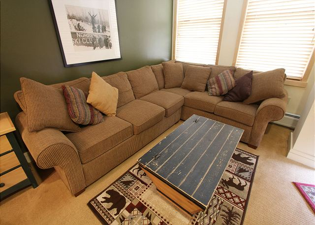 The living room features a queen-sized sleeper sofa.