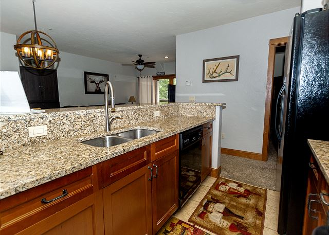 Kitchen features new granite countertops.