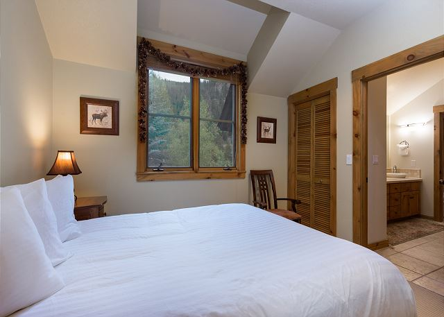 The second guest bedroom features a queen-sized bed and has access to a jack-and-jill bathroom.