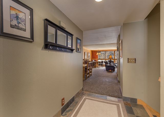 View of Living Area from Entryway Stairs