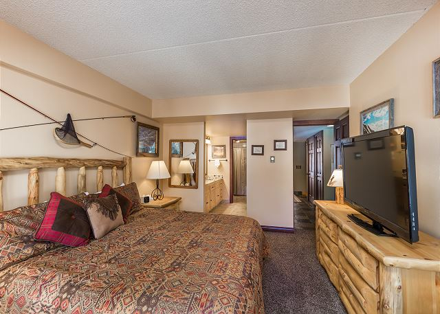 The master bedroom features a king-sized bed, a flat screen TV and beautiful views.
