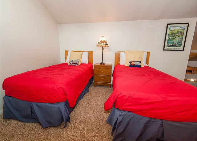 The second guest bedroom is in the upstairs loft and has two twin-sized beds and a flat screen TV.