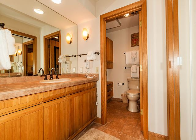 The guest bedroom has its own private vanity and entrance to the guest bathroom.