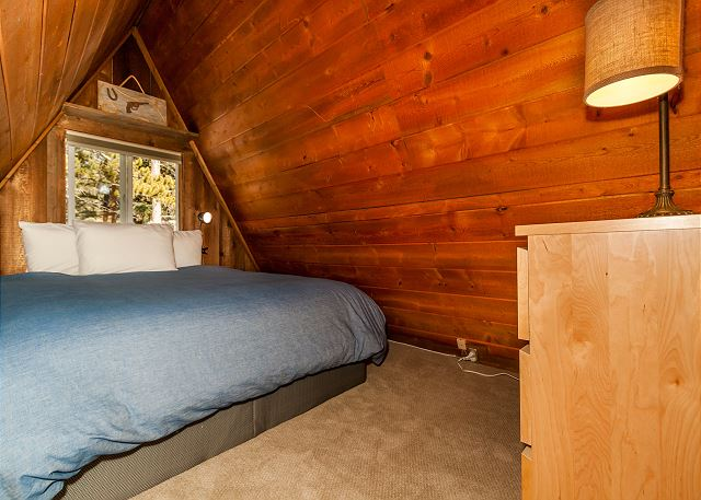 The second bedroom is in the loft and has a queen-sized bed. It can be accessed by ladder.