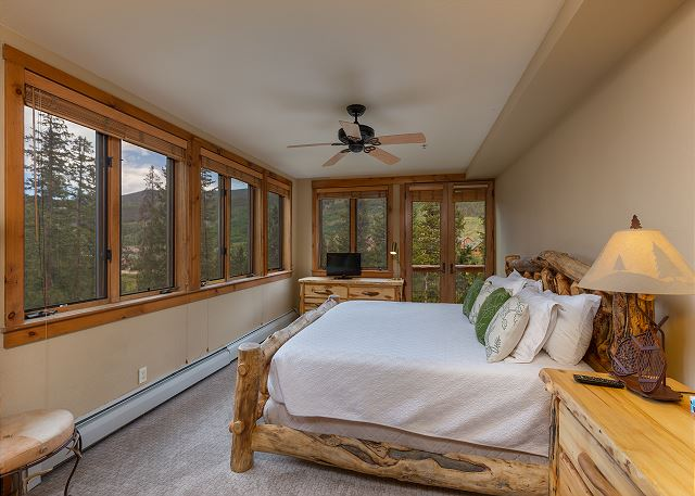The master bedroom features a king-sized bed, a flat screen TV and its own entrance to the private balcony. Windows line two walls and offer beautiful views.