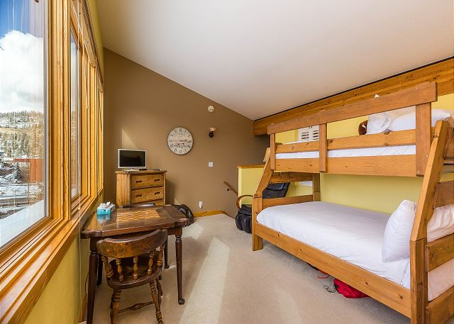 The second guest bedroom is in the upstairs loft and has a twin-over-full bunk, a flat screen TV and a massage chair. There is also a twin-sized foldout bed in the closet.