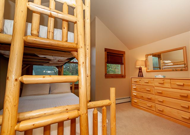 The second guest bedroom features a twin-over-full bunk bed and shares a bathroom with the first guest bedroom.