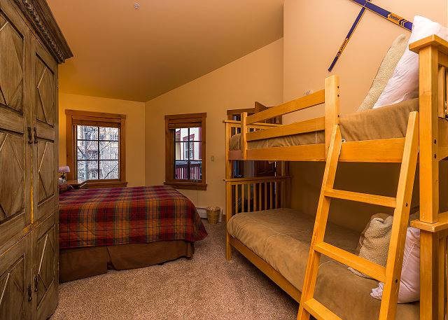 The guest bedroom sleeps four with a full-sized bed and a bunk bed. There is also a flat screen TV.