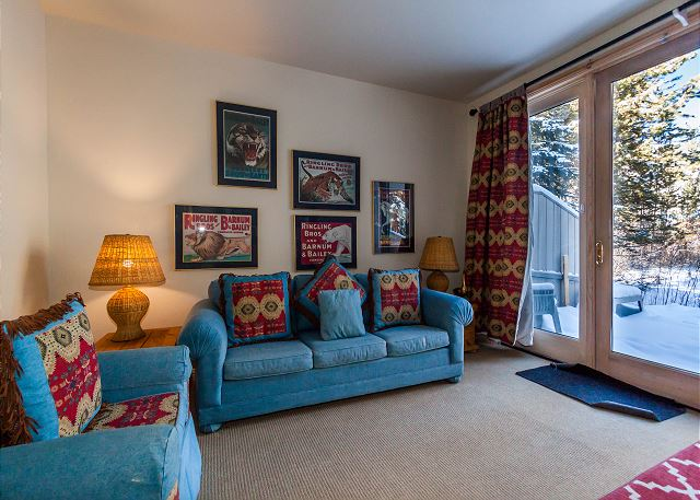 The den features a flat screen TV, a queen-sized sleeper sofa and a walk-out patio with a hot tub.